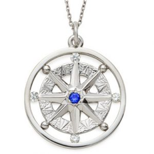 Compass Rose pendant with sapphire center and 4 diamonds in white gold