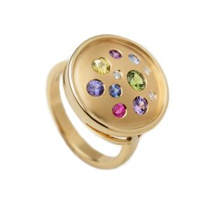 fancy color sapphire round galaxy ring
