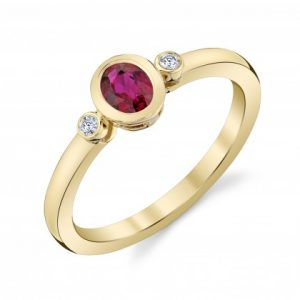 Oval Ruby and diamond petite bezels ring
