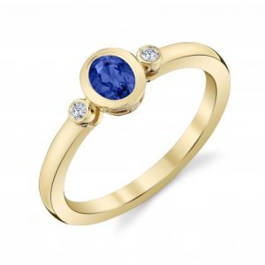 Blue Sapphire and diamond bezel ring