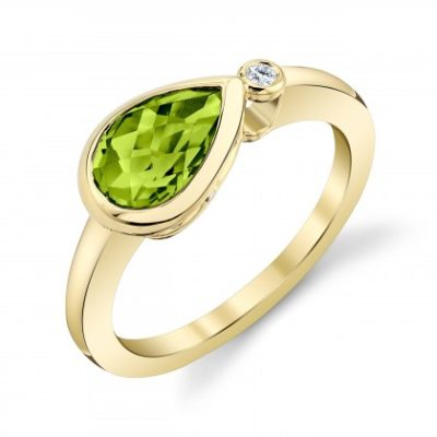 Sideways pear peridot ring