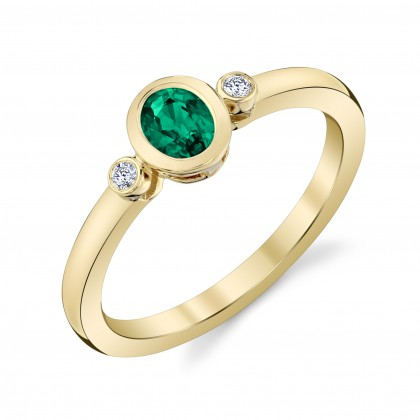 Emerald and Diamond bezel set ring in yellow gold