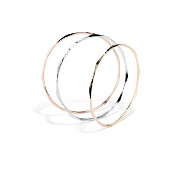 Ripple bangles shown in rose gold, white gold, and yellow gold